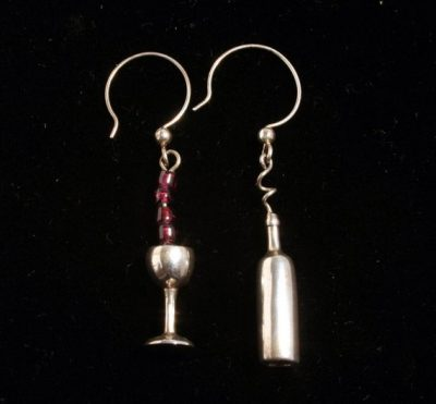 Sterling silver wine bottle and wine glass with garnet beads on silver wire dangles.